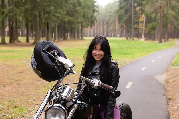 Happy girl on a motorcycle