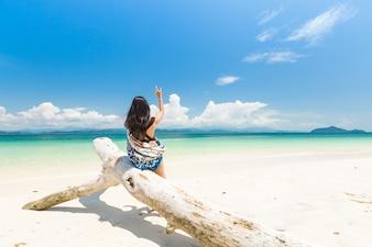Happy girl on White sand beach and Long-tail boat at Khang Khao Island (Bat island)
