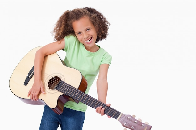 Happy girl playing the guitar