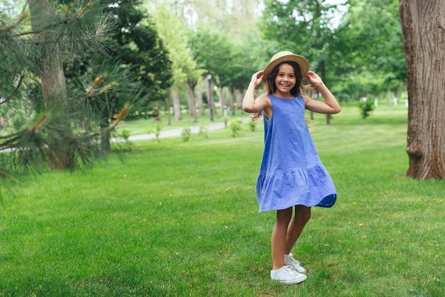 Happy girl posing outdoors
