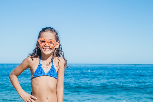Happy girl posing with goggles