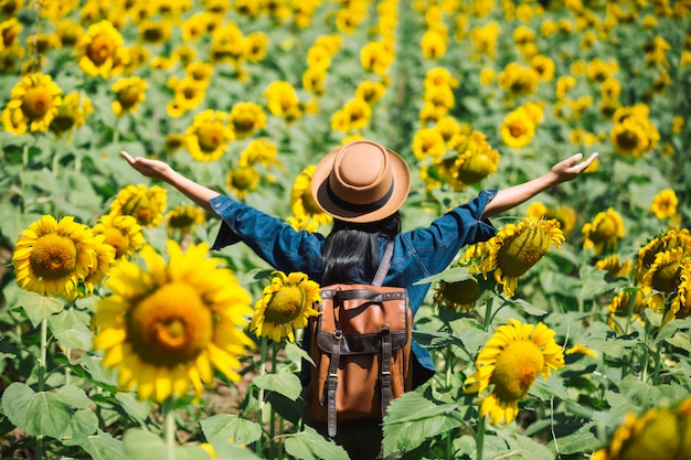 Happy girl in sunflower field.