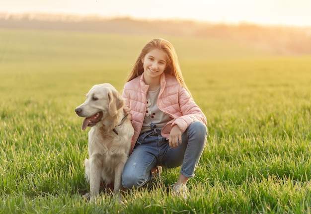 Happy girl with cute dog