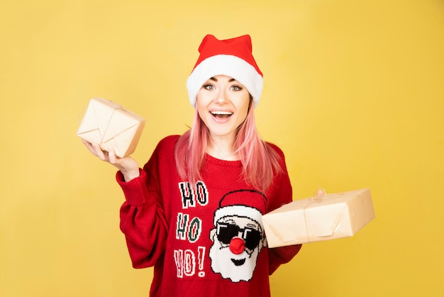 Happy girl with gifts in hands 2