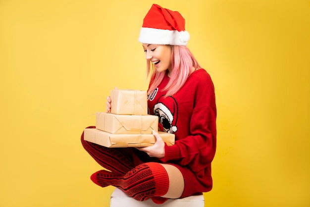 Happy girl with gifts in hands