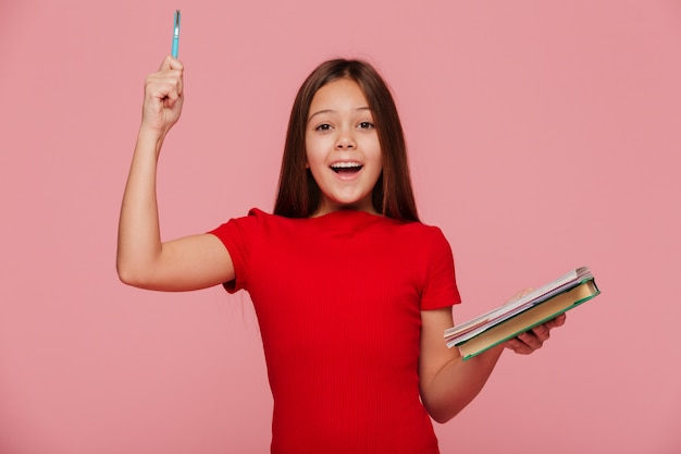 Happy girl with pencil and books have and idea an smiling isolated