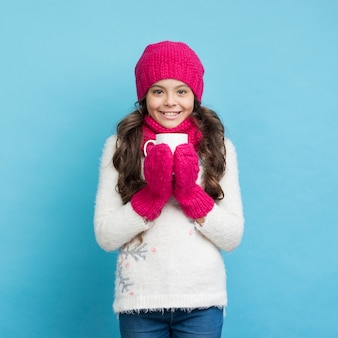 Happy girl with winter clothes smiling