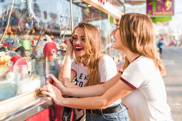 Happy girls having fun in the amusement park