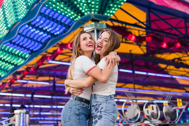 Happy girls having fun in the amusement park