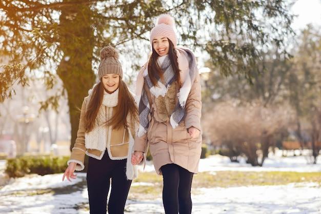 Happy girls in a winter city