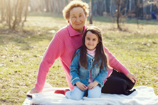 Happy grandmother and granddaughter in a park