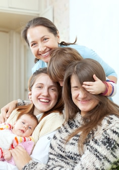 Happy grandmother with daughters and granddaughters
