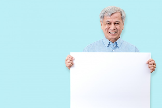 Happy grandpa smiling with white teeth, enjoy moment and holding a blank board.
