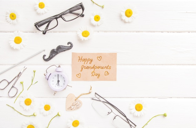 Happy grandparents day flat lay. grandparents holiday gift card, granny and grandpa's day celebration