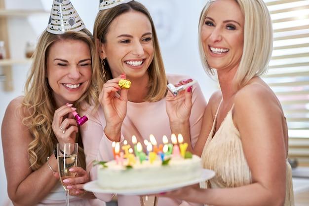 Happy group of friends celebrating birthday