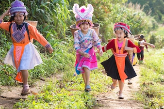 Happy group of hill tribe The Girl wearing a Hmong while running in hill at Phuhinrongkla