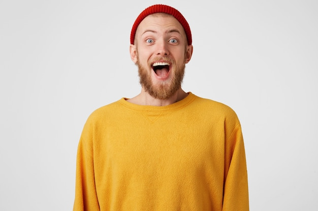 Happy guy is ready to jump from happiness. bearded man with blue eyes overwhelmed with positive emotions