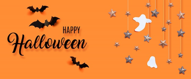Happy halloween celebration concept with bats, ghost, stars