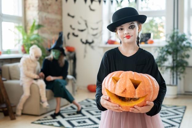 Happy halloween girl holding jackolantern