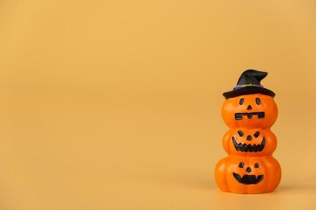 Happy halloween, pumpkins on orange background, halloween concept. copy space.