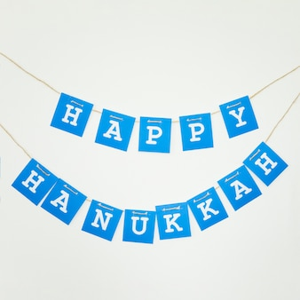 Happy hanukkah garland on wall