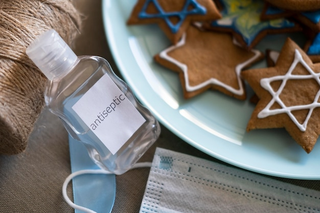 Happy hanukkah holiday cookies and hand sanitizer