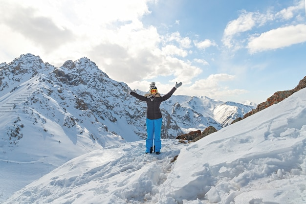 Happy hiker winning reaching life goal success freedom and happiness achievement in mountains