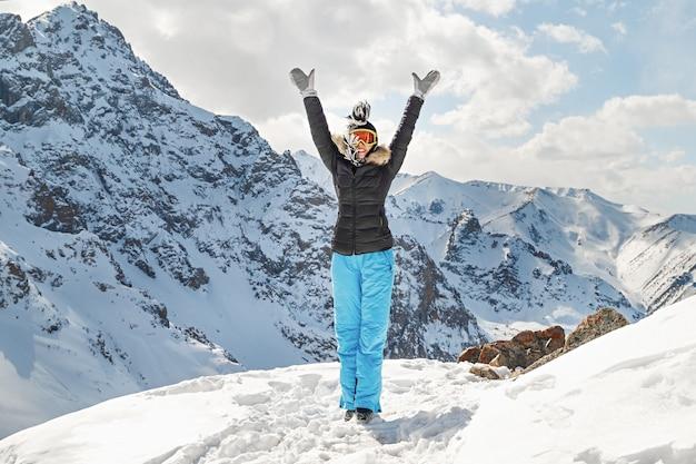Happy hiker winning reaching in mountains tian shan mountain travel