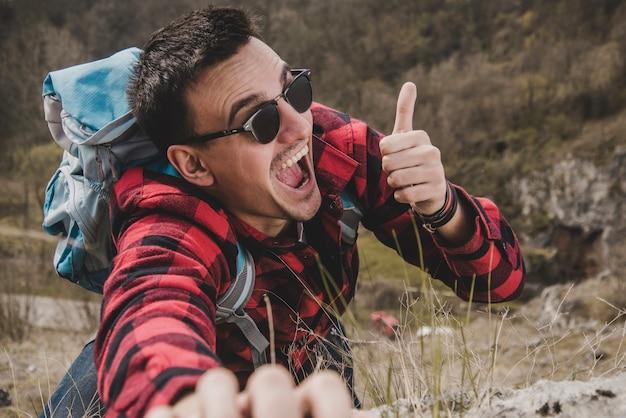 Happy hiker with positive gesture