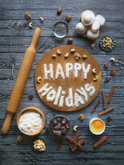 Happy holidays food background. egg, flour and nuts are laid out on a wooden table.
