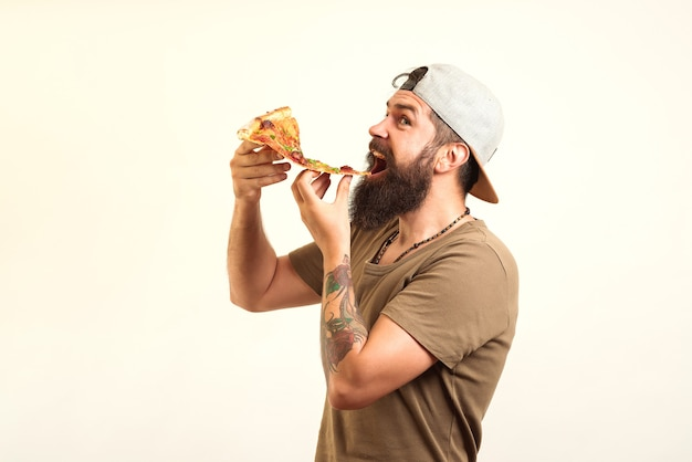 Happy hungry man eating pizza