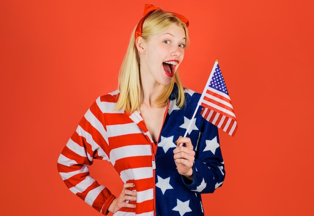 Happy independence day. patriotic holiday. smiling girl with american flag. usa celebrate 4th of july.