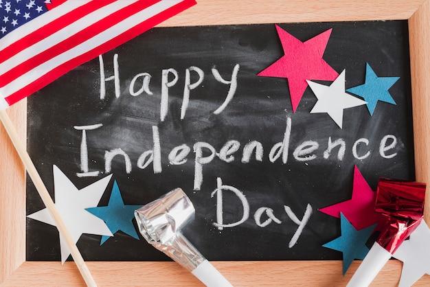 Happy independence day sign on framed blackboard