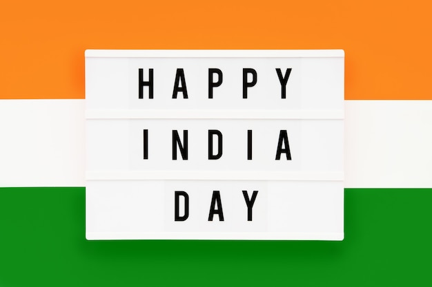 Happy india day in a lightbox on a background of indian flag color.