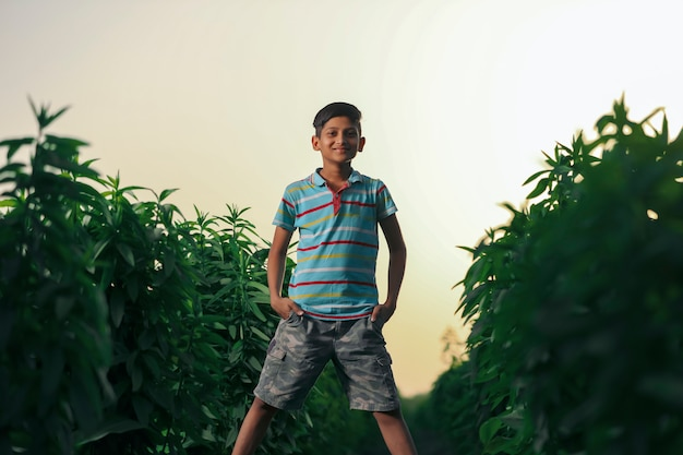 Happy indian child playing at ground