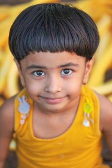 Happy indian girl child playing at ground