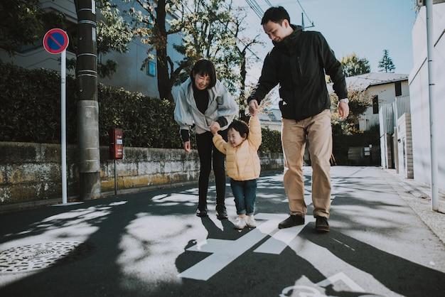 Happy japanese family spending time outdoor
