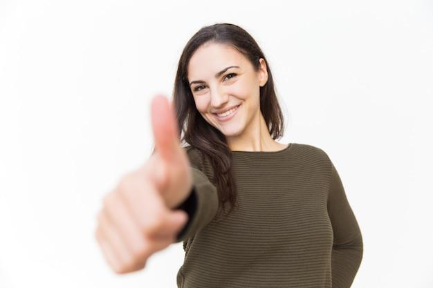 Happy joyful beautiful woman showing thumb up