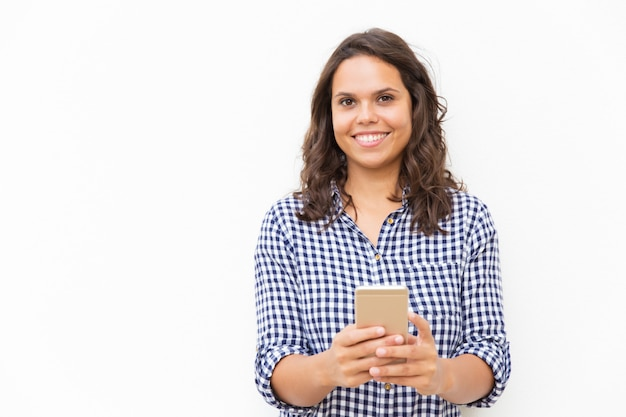 Happy joyful female customer holding cell