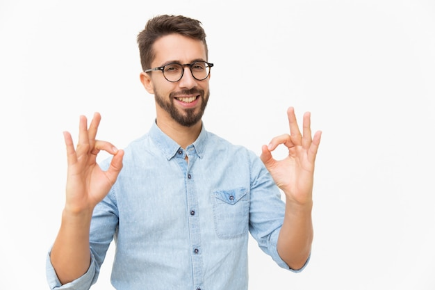 Happy joyful guy showing ok gesture