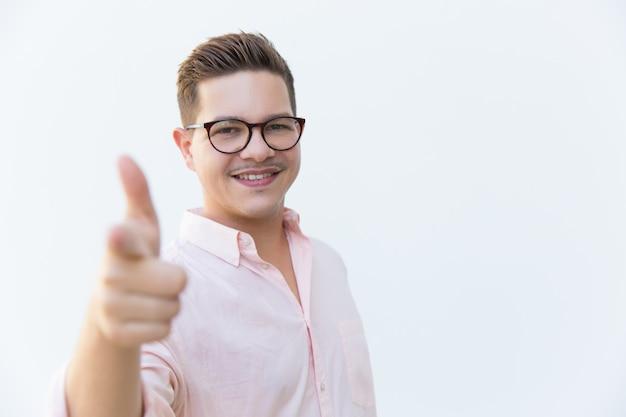 Happy joyful professional pointing index finger