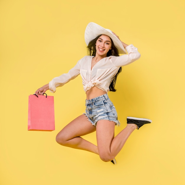 Happy jumping female in white hat