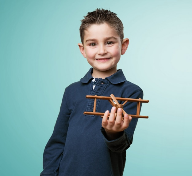 Happy kid holding a toy plane
