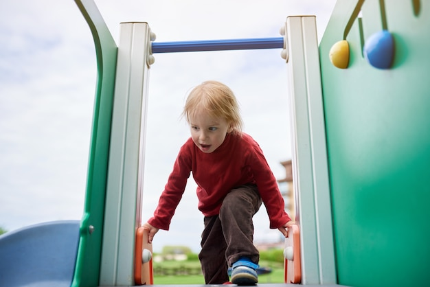 Happy kid playing at the playground