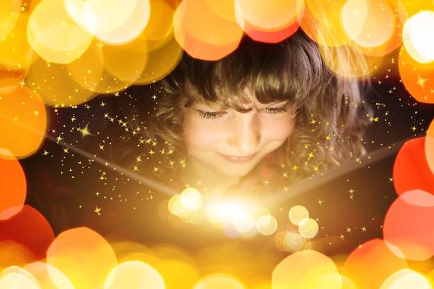 Happy kid reading magic book