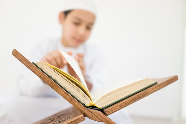 Happy kids reading koran