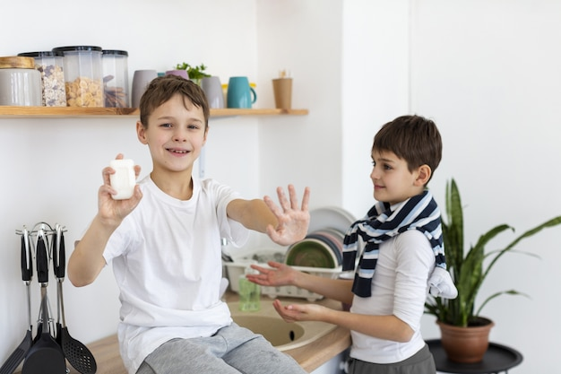 Happy kids showing their clean hands while holding soap