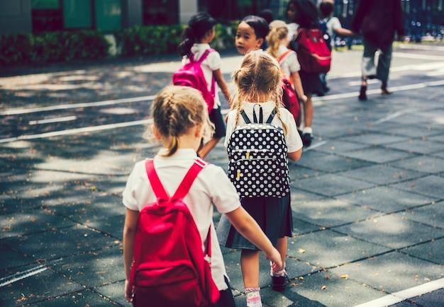 Happy kids walking at an elementary school
