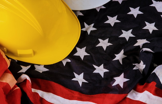 Happy labor day american patriotic usa flag and yellow helmet