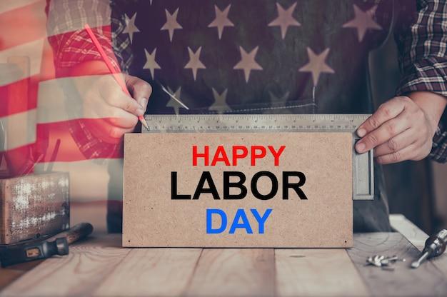 幸せな労働者の日の背景。アメリカとアメリカでの独立と記念日。エンジニアと労働者のツール。